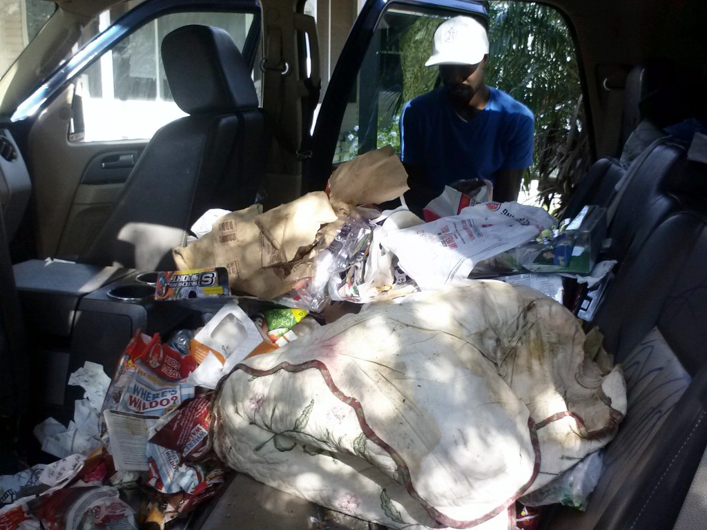 Cleaning Car Interior Trash Before Detaining In Clearwater